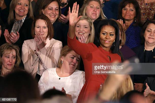S first lady Michelle Obama waves goodbye after delivering remarks honoring the 2017 School Counselor of the Year and counselors from across the...