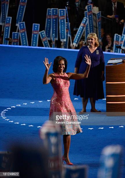 First lady Michelle Obama waves on stage after being introduced by Elaine Brye during day one of the Democratic National Convention at Time Warner...