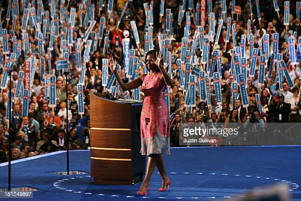 First lady Michelle Obama waves on stage after speaking during day one of the Democratic National Convention at Time Warner Cable Arena on September...