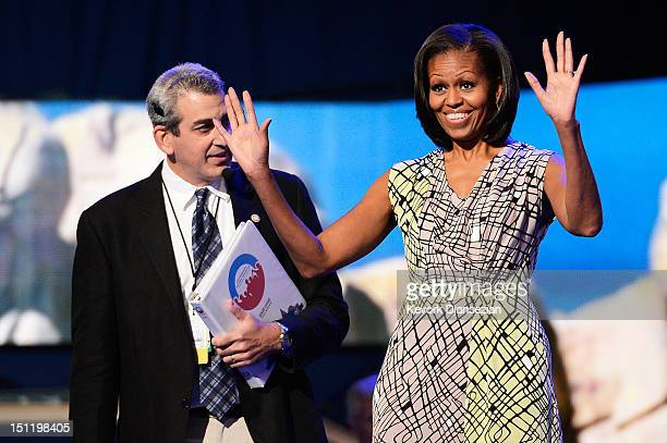 First lady Michelle Obama waves on stage during a soundcheck with stage manager David Cove during preparations for the Democratic National Convention...