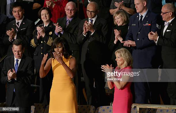 First lady Michelle Obama waves to members of the congress as Gov Dannel P Malloy of Connecticut and Wife of US Vice President Joe Biden Dr Jill...