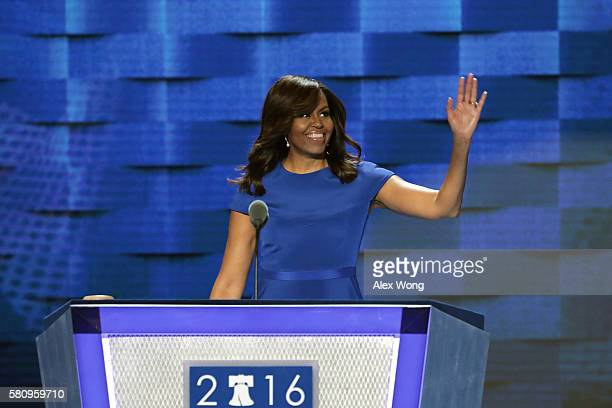 First lady Michelle Obama waves to the crowd before delivering remarks on the first day of the Democratic National Convention at the Wells Fargo...