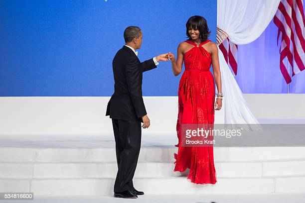 First lady Michelle Obama, wearing a Jason Wu dress, with U.S. President Barack Obama at the Commander in Chief's Ball in Washington.