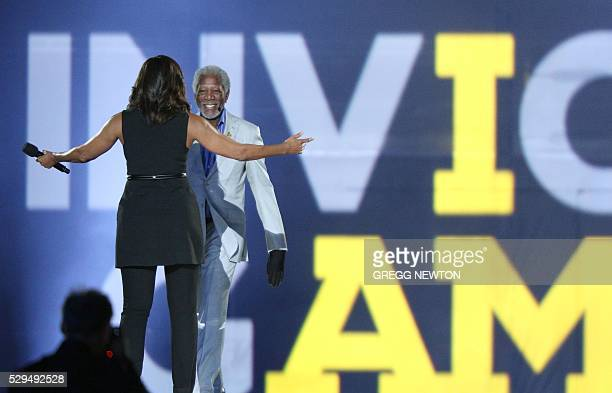 US First Lady Michelle Obama welcomes actor Morgan Freeman on stage during opening ceremonies for the 2016 Invictus Games in Orlando Florida May 8...