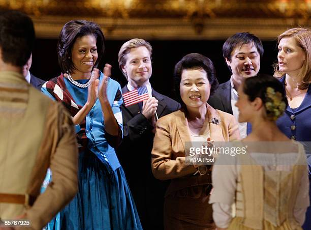 US first lady Michelle Obama wife of Britain's Prime Minister Sarah Brown and First Lady of the Republic of Korea Kim YoonOk applaud dancers after...