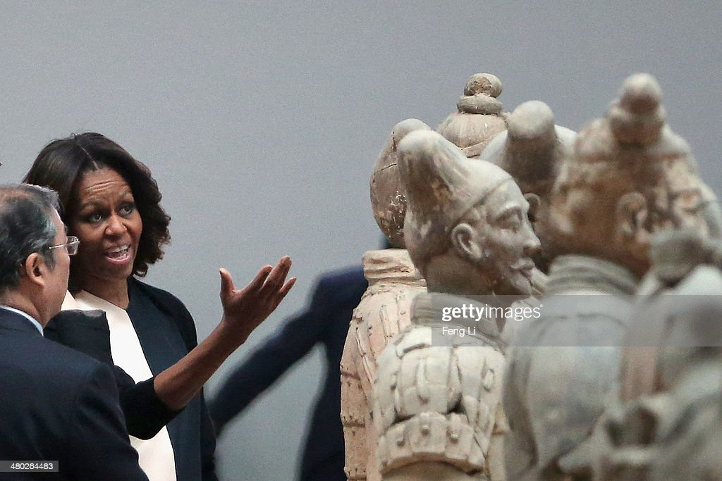 XI'AN, CHINA - MARCH 24: First Lady Michelle Obama with her daughters Malia Obama and Sasha Obama, mother Marian Robinson visit Museum of Terracotta Warriors during a visit to the historic excavation site on March 24, 2014 in Xi'an, China. Michelle Obama's one-week-long visit in China will be focused on educational and cultural exchanges.