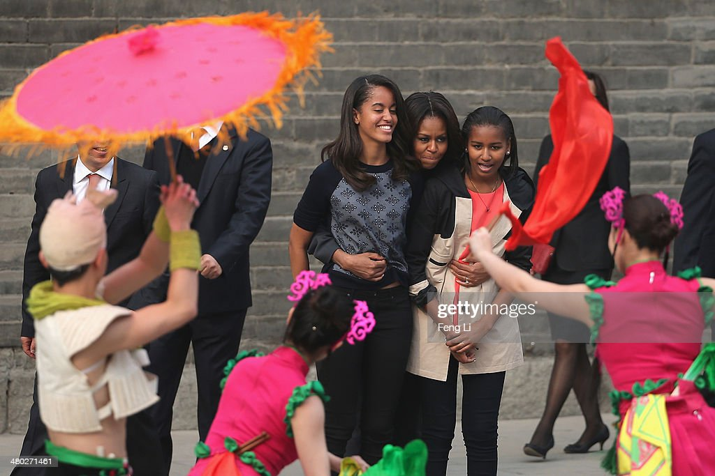 XI'AN, CHINA - MARCH 24: First Lady Michelle Obama (Center) with her daughters Malia Obama (Left) and Sasha Obama (Right), mother Marian Robinson visit the Xi'an City Wall on March 24, 2014 in Xi'an, China. Michelle Obama's one-week-long visit in China will be focused on educational and cultural exchanges. Michelle Obama's one-week-long visit in China will be focused on educational and cultural exchanges.