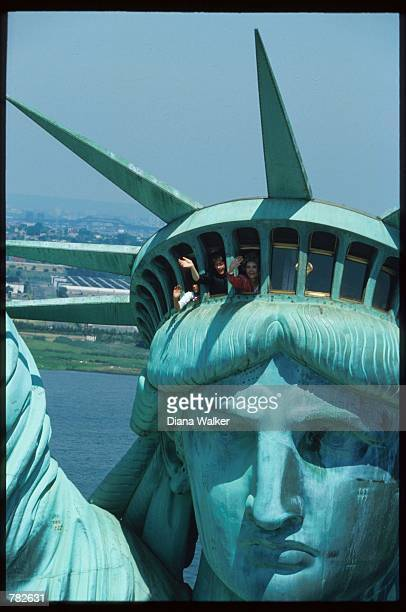 First Lady Nancy Reagan and schoolchildren wave from the crown of the Statue of Liberty during the monument's centennial celebration July 4 1986 in...