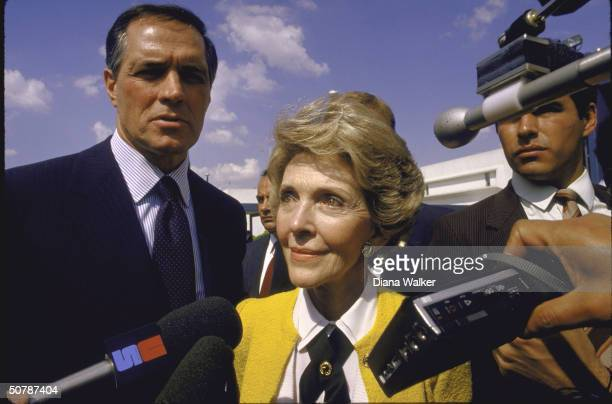 First Lady Nancy Reagan listens to questions from the press while touring the devastation of a earthquake that killed thousands of people and left...