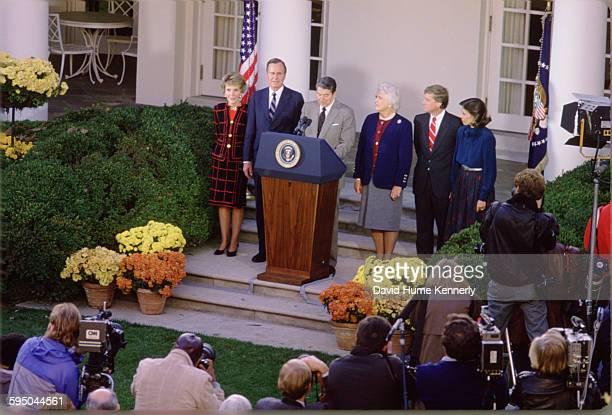 First Lady Nancy Reagan, President-Elect George H.W. Bush, President Ronald Reagan, Mrs. Barbara Bush, Vice President-Elect Dan Quayle, and Mrs....