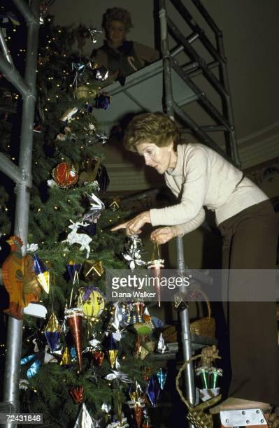 First Lady Nancy Reagan trimming Christmas tree