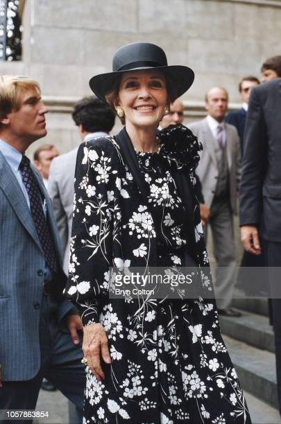 First Lady Nancy Reagan, wearing a red and white outfit, leaves St.Paul's Cathedral after attending the royal wedding rehearsal for the marriage of...