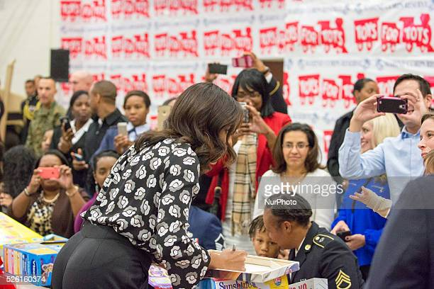 C — First Lady Obama signs the back of Kelsey Gettle's canvas print of her son William pictured with President Obama and First Lady Obama at last...