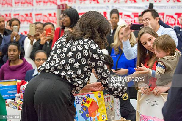 C — First Lady Obama talks to Kelsey Gettle after signing the back of her canvas print that pictures her 1 1/2 yearold son William at 7monthsold with...
