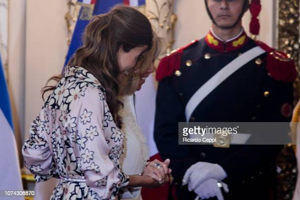 First Lady of Argentina Juliana Awada and First Lady of France Brigitte Macron smile during a meeting between presidents of France and Argentina as...