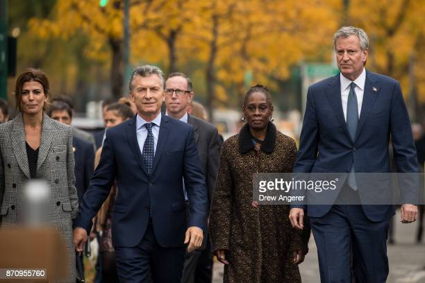 First Lady of Argentina Juliana Awada Argentinian President Mauricio Macri Chirlane McCray and New York City Mayor Bill de Blasio walk along a bike...