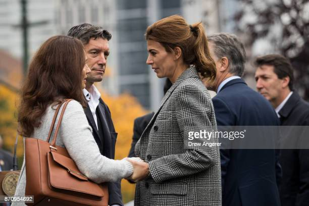 First Lady of Argentina Juliana Awada comforts mourners during a tribute for the victims of last week's vehicular attack on the bike path next to the...