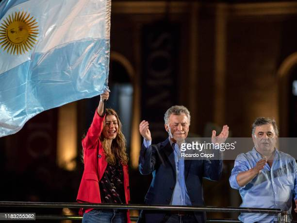 First Lady of Argentina Juliana Awada waves an Argentine flag as President of Argentina and Presidential candidate Mauricio Macri applauds with...