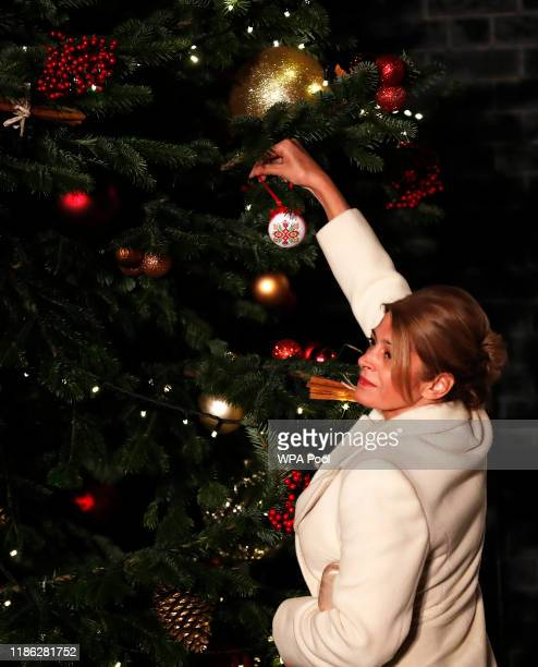 First Lady of Bulgaria Desislava Radeva, the wife of Bulgarian President Rumen Radev places a bauble on a Christmas tree as they arrive at 10 Downing...
