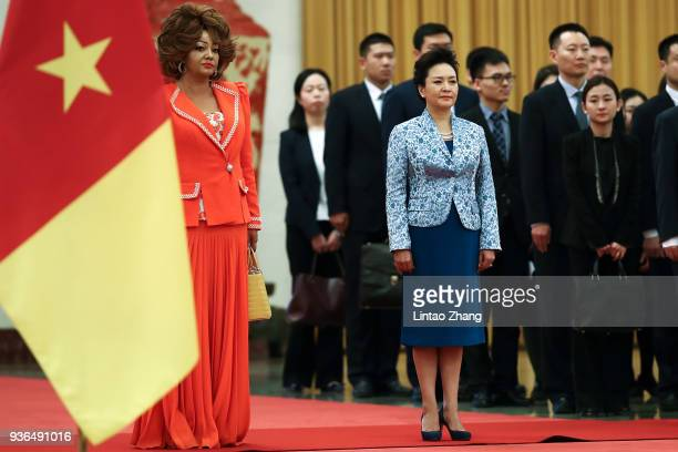 First Lady of Cameroon Chantal Biya and First Lady of China Peng Liyuan attend a welcoming ceremony inside the Great Hall of the People on March 22...