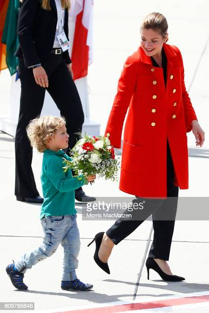 First lady of Canada Sophie Trudeau and her youngest son Hadrien Trudeau arrive at Hamburg Airport for the Hamburg G20 economic summit on July 6,...