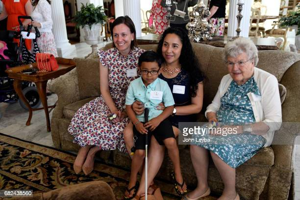 First Lady of Colorado Robin Hickenlooper and former First Lady Bea Romer pose for a photo with Giovanni Ruvalcaba 5yearsold and his mother Adriana...