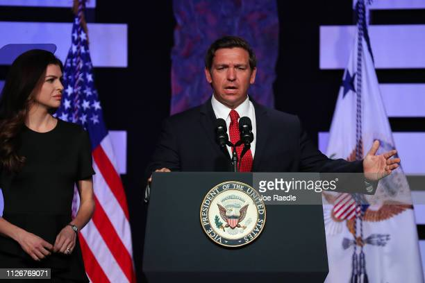 First Lady of Florida Casey DeSantis listens as her husband Florida Gov Ron DeSantis makes remarks before Vice President Mike Pence speaks at Iglesia...