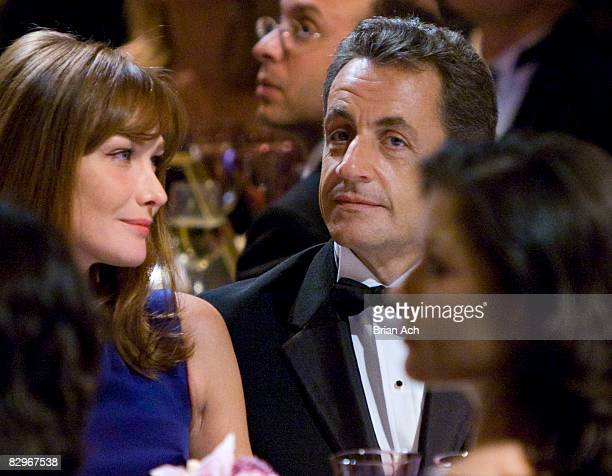 First lady of France Carla BruniSarkozy President of France Nicolas Sarkozy and actress Catherine ZetaJones at the Elie Wiesel Foundation for...