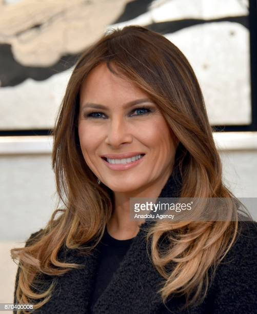 First Lady of the United States Melania Trump poses for a photo at Mikimoto Ginza Main Store during her meeting with Japanese Prime Minister Shinzo...