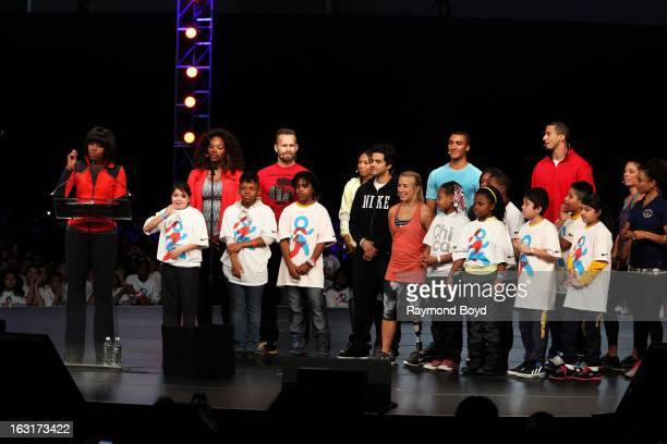 First Lady of the United States Michelle Obama speaks as athletes Serena Williams Bob Harper Allyson Felix Paul Rodriguez Sarah Reinertsen Ashton...