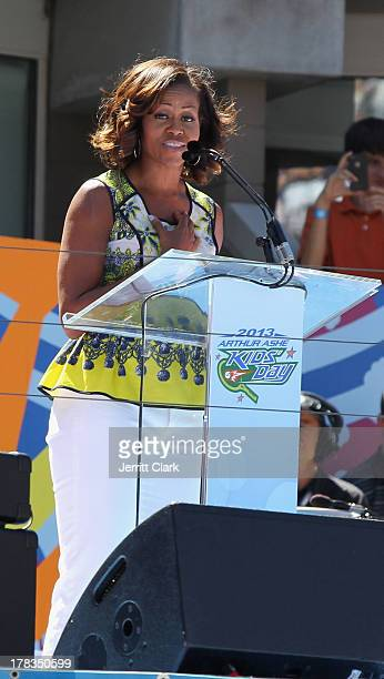 First Lady of the United States Michelle Obama speaks at the 2013 Arthur Ashe Kids Day at USTA Billie Jean King National Tennis Center on August 24...