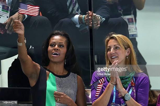 First Lady of the United States Michelle Obama supports the USA Olympic Swim team along with Summer Sanders durng the evening session of the swimming...