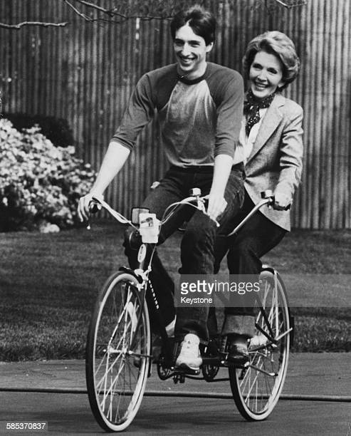 Nancy Reagan wife of President Ronald Reagan riding a tandem with their son Ron Jr in the South Grounds of the White House Washington DC May 1st 1981
