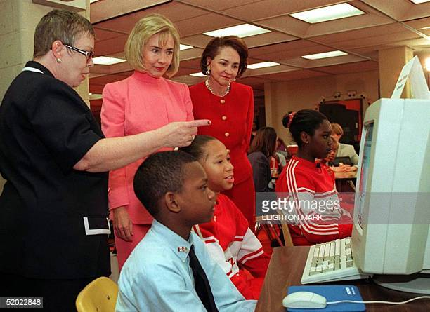 First Lady of the US Hillary Clinton and Aline Chretien of Canada are given a demonstration of Schoolnet by Linda Johnson, librarian and project...