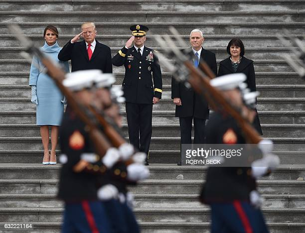 First Lady of the US Melania Trump President Donald Trump US Army Maj General Bradley Becker Vice President Mike Pence and Karen Pence look on at the...