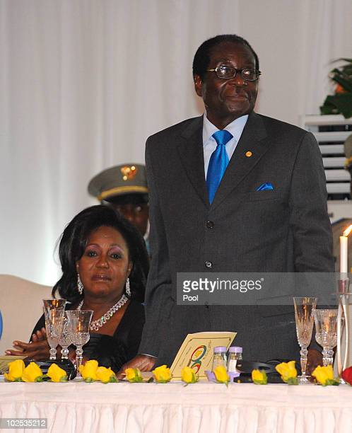 First Lady of Zimbabwe Grace Mugabe and President of Zimbabwe Robert Mugabe attend a gala dinner at Cite de l'Union Africaine on June 29 2010 in...