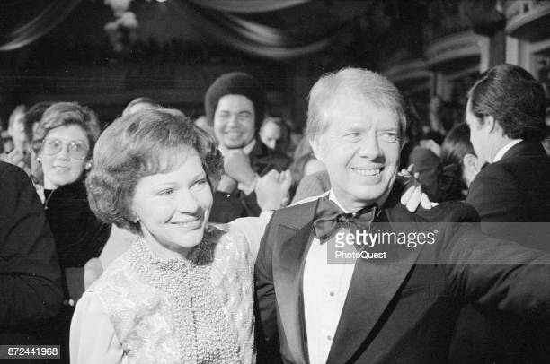First Lady Rosalyn Carter and President Jimmy Carter greet wellwishers as they dance during one of their Inaugural Balls Washington DC January 20 1977