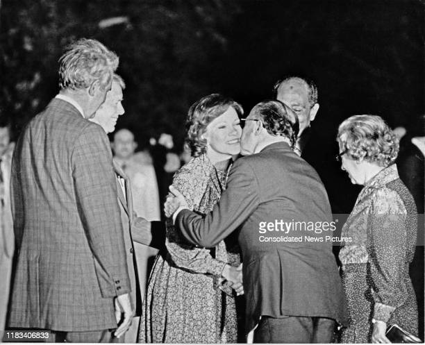 US First Lady Rosalynn Carter and Israeli Prime Minister Menachem Begin share a kiss on the cheek a kiss on the South Lawn of the White House...