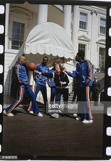 First Lady Rosalynn Carter lets one get away as she tried to balance a basketball on her fingertips during a photo session with the world famous...