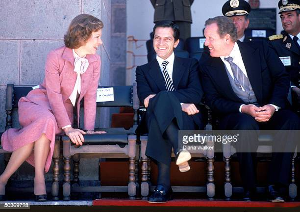 First Lady Rosalynn Carter Prime Minister Adolfo Suarez and unident at cermony marking the retirement of the 3Man Military Junta