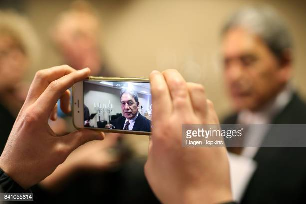 First leader Winston Peters is filmed on a mobile phone while speaking to media during the Economic Development Agencies of New Zealand Conference at...