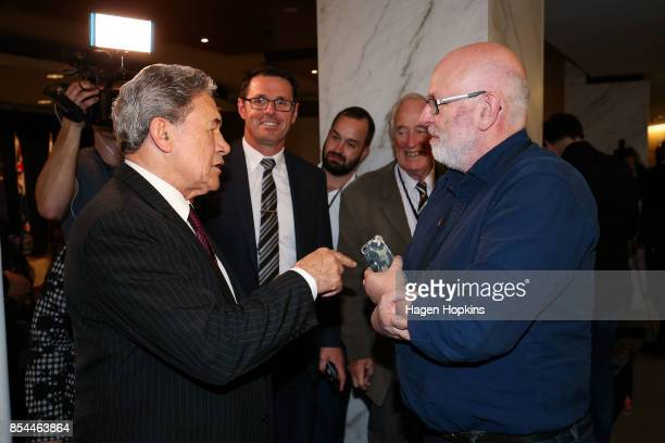 First leader Winston Peters speaks to journalist Vernon Small after a press conference at the Beehive Theatrette on September 27, 2017 in Wellington,...