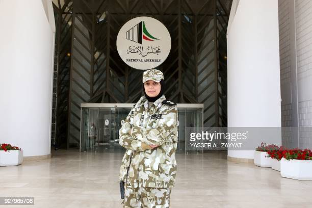 First lieutenant Sarah AlSarraf a female member of the Kuwaiti National Assembly guards poses for a picture outside the National Assembly in Kuwait...