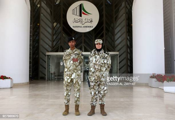 First lieutenant Sarah alSarraf and Officer AlJazy Abdul Quddus female members of the Kuwaiti National Assembly guards pose for a picture outside the...