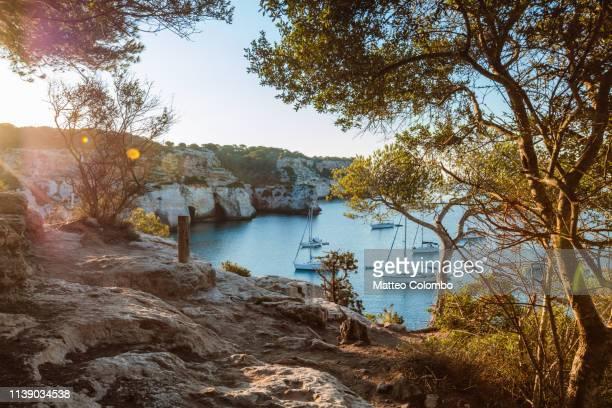 first light on cala macarella bay, menorca, spain - カラマカレラ ストックフォトと画像