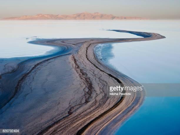 first light on curvy sandbank at salt lake, utah, usa - salt lake city stock pictures, royalty-free photos & images