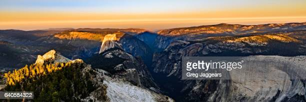 first light on half dome from clouds rest, yosemite national park - first half sport stock pictures, royalty-free photos & images