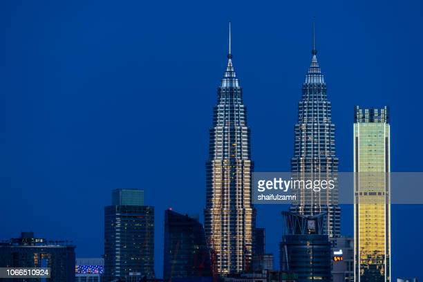 First light over Petronas Twin Towers,  a pair of glass and steel clad skyscrapers (451m).