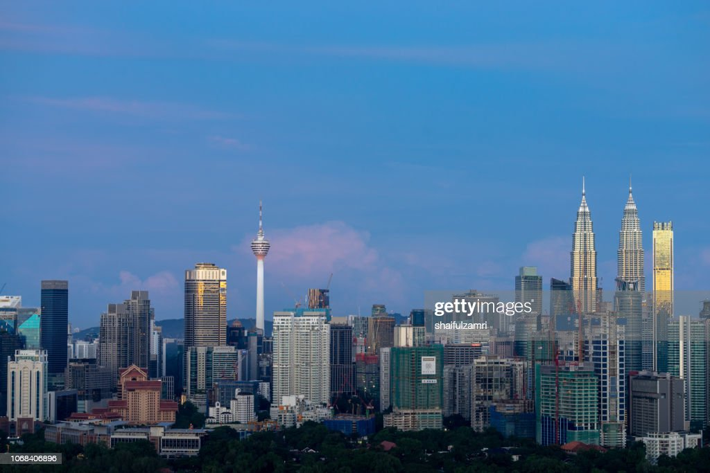 First light over Petronas Twin Towers,  a pair of glass and steel clad skyscrapers (451m). : Stock Photo