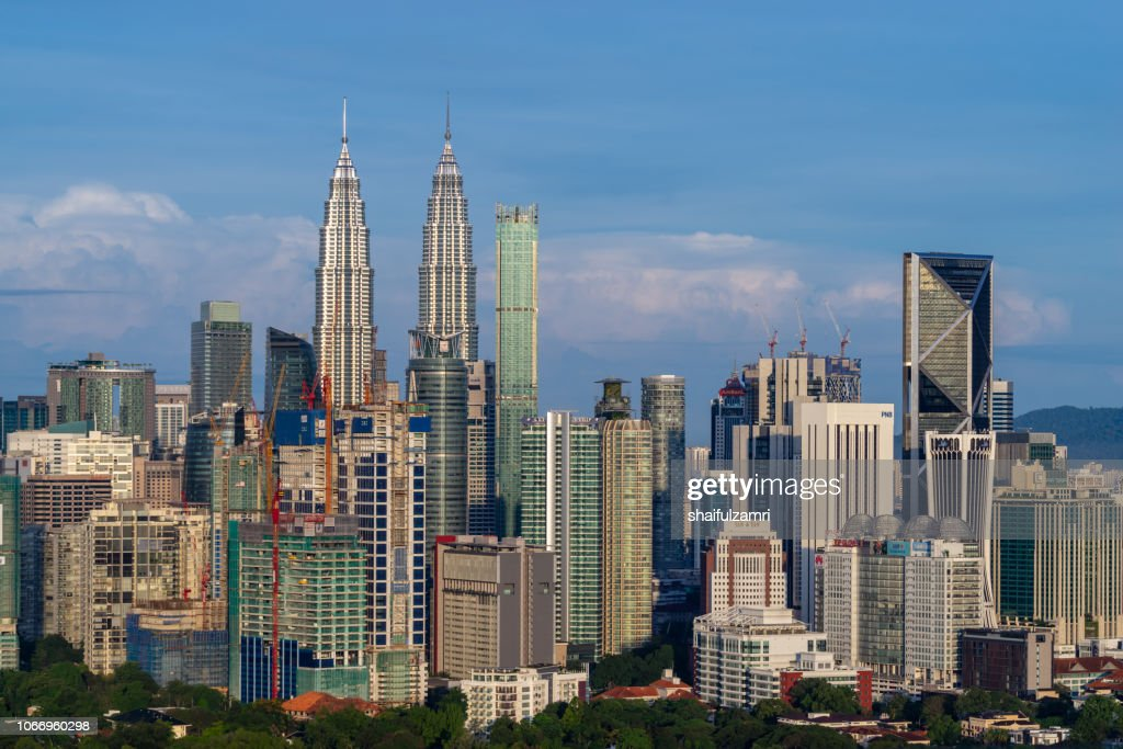 First light over Petronas Twin Towers or Kuala Lumpur City Centre (KLCC),  a pair of glass and steel clad skyscrapers (451m). : Stock Photo